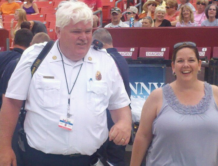 PIO Brady talks with fan at concert at Fed Ex Field