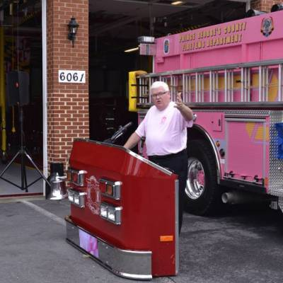 PIO Mark Brady serves as Emcee at the Housing of the Departments Pink Pumper